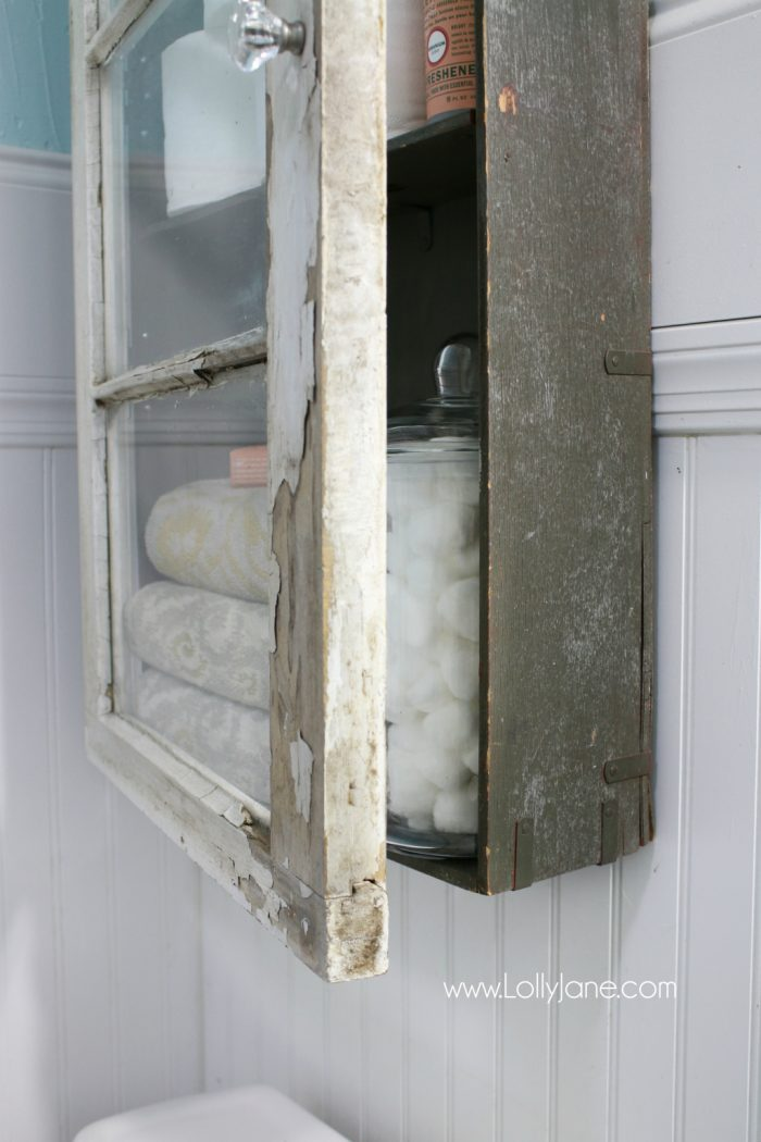 An old trunk and window created this bathroom cabinet!? Such an unreal DIY!