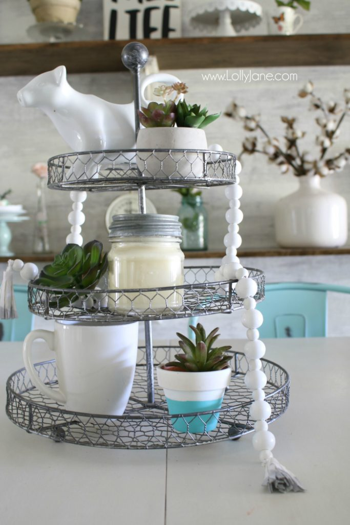 DIY How to make a wood bead garland. Jump on this hot home decor trend of wood beads! Accessorize your home decor with cute wood bead garlands and for less than $5! Love these diy wood bead garlands!