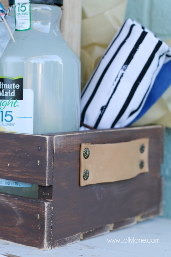 DIY Father's Day gift basket | Grab this premade crate but dress it up with some paint and leather handles. Fill it with your dad's favorite goodies to create the perfect Father's Day gift! Love this DIY Fathers Day gift basket!