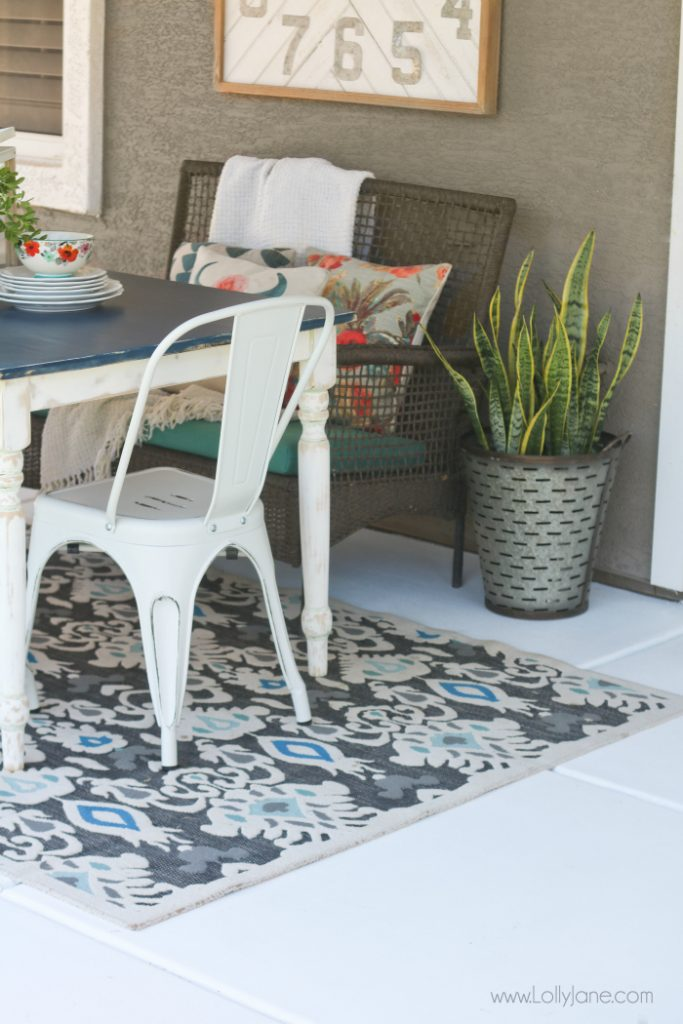 Easy porch makeover... love the white concrete paint tutorial! So fresh and bright  - painted concrete patio tutorial