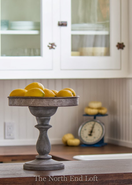 Love this DIY Rustic Pedestal then fill it with faux lemons for some easy and cute lemon home decor ideas!