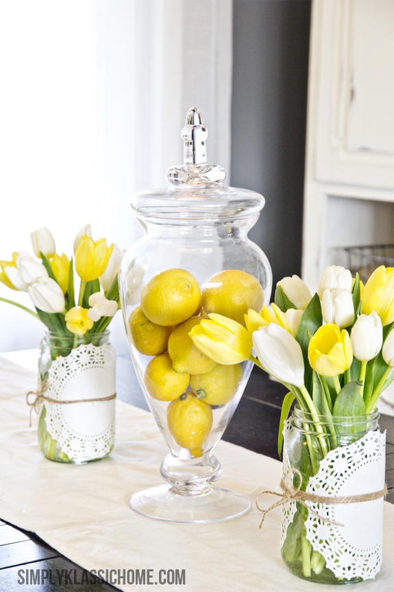Pull together this easy lemon centerpiece decor with lemons in a jar and fresh tulips.