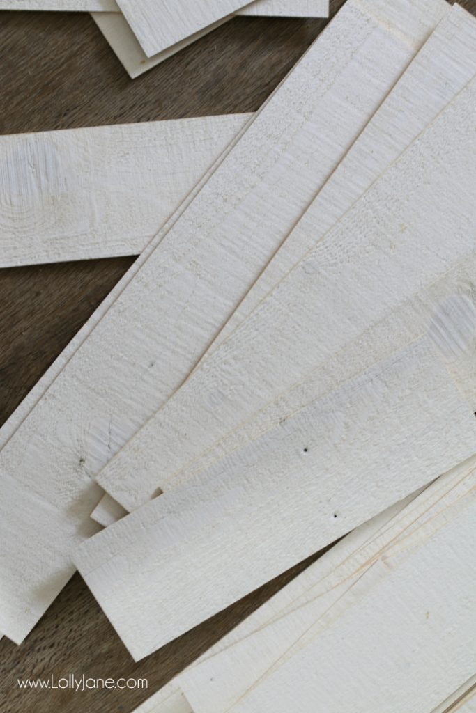 Peel and stick shiplap!! This is super easy to install and has an amazing after look! Love this pretty peel and stick barnwood wall! Stikwood is so easy to use!