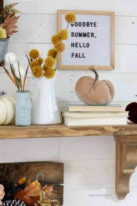 Cute letter board bidding summer farewell and welcoming fall with this easy autumn mantel!