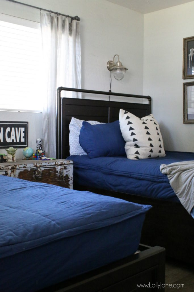 Looking for space saving tips for a shared bedroom? Love these ways to organize a boys room with cute matching bedding too!