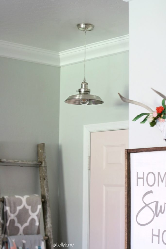 Styled entryway with the cutest mini metal pendant!