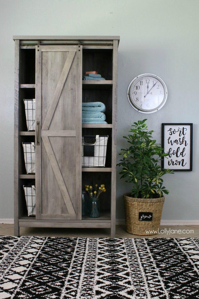 Love this modern farmhouse laundry room makeover! Check out this before/after laundry room makeover!