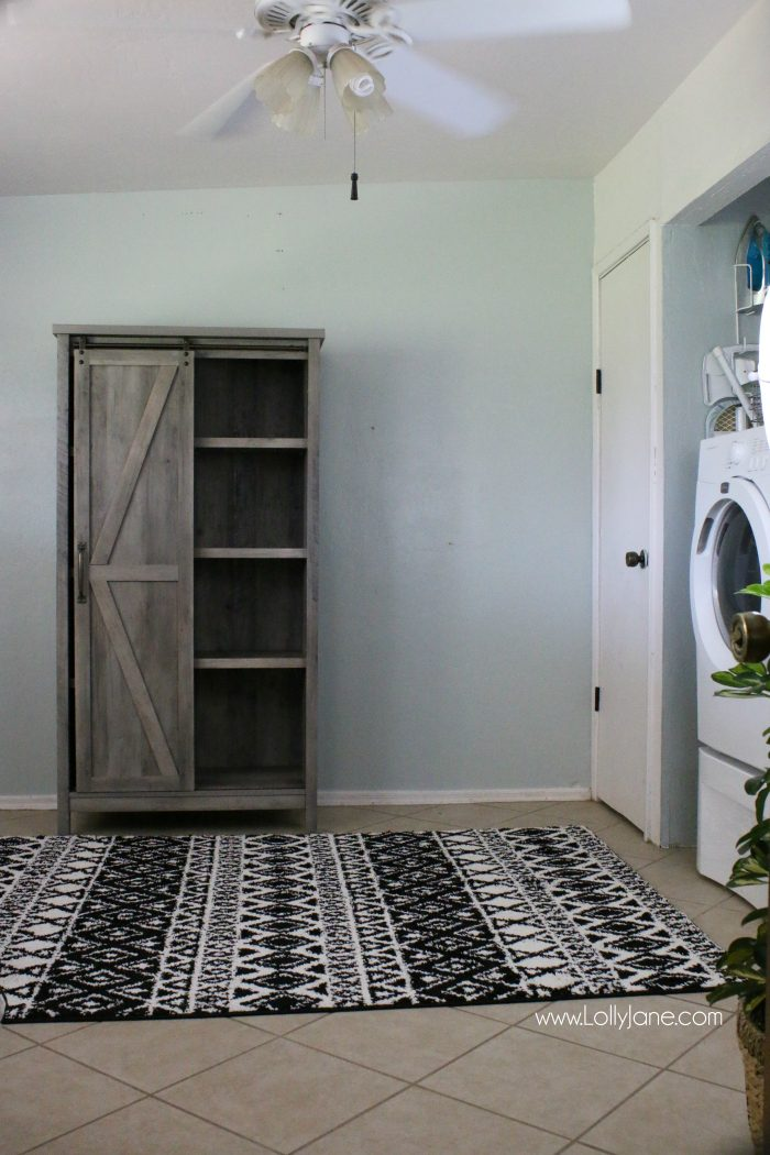 This modern farmhouse storage unit is so cute! LOVE this farmhouse barndoor cabinet!