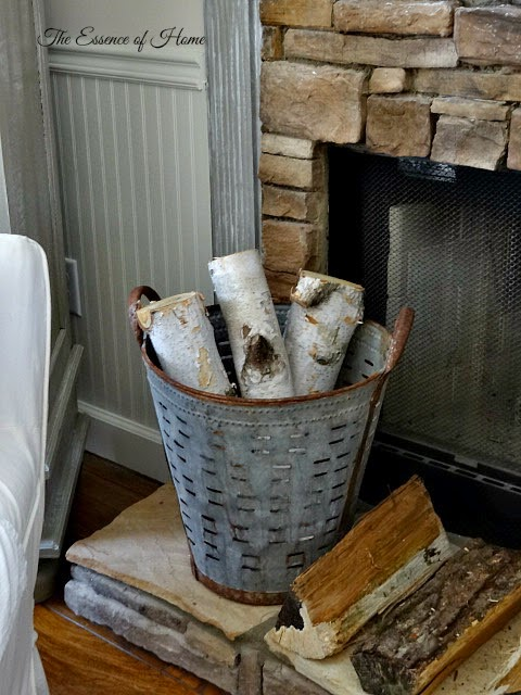 An Olive Bucket Filled With Logs Is A An Attractive Way To Store Firewood:  Practical Decor, Via The Essence Of Home.