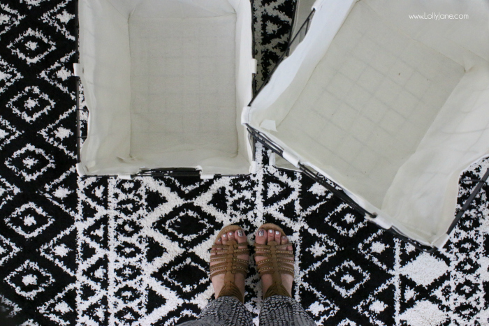 Love these stylish Walmart finds! Cute wire baskets and this trendy aztec black and white rug make great accessorizes for this farmhouse laundry room makeover!