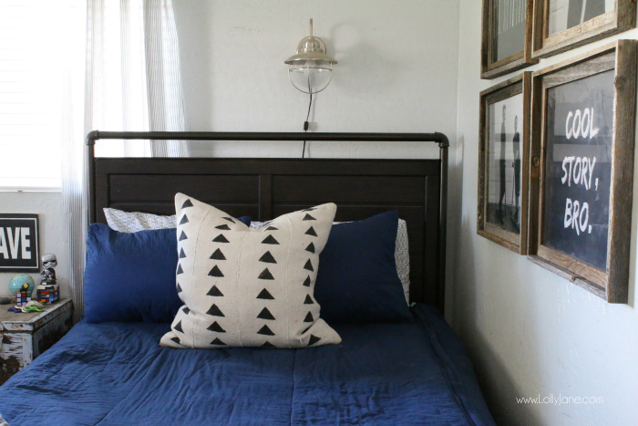 Love this mud cloth pillow boys bedroom decor. Cute boys shared bedroom ideas, love the gray and navy boys room decor ideas!