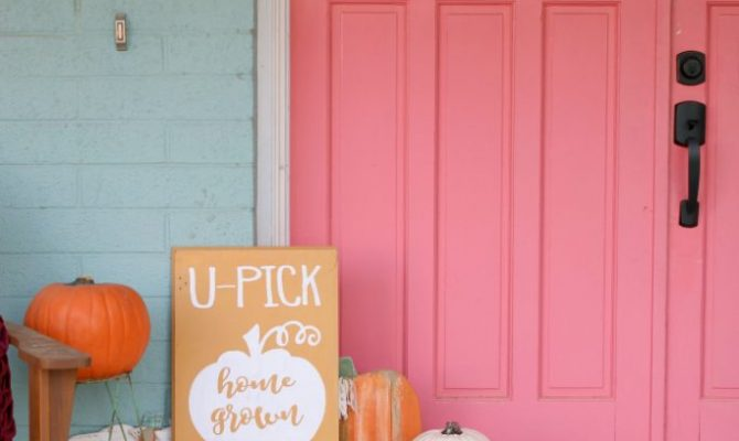 """Cute """"U-Pick Pumpkins"""" sign, perfect touch to this colorful farmhouse fall porch!"""