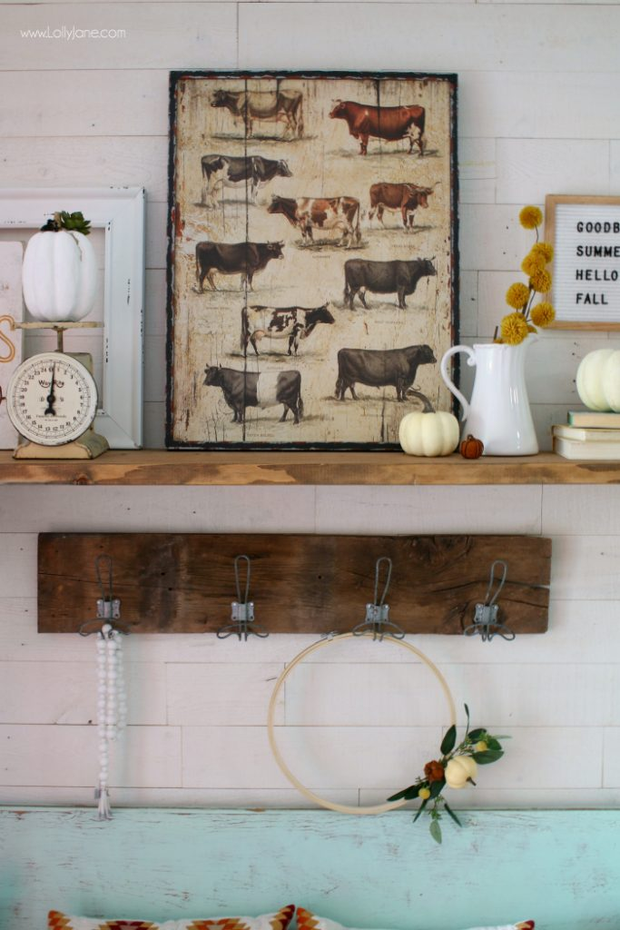 This fall mantel is the perfect way to welcome guests and gets this colorful farmhouse in the fall spirit!