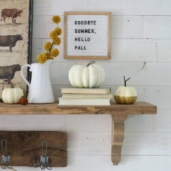Cute pops of fall on this mantel! Love the vintage scale!
