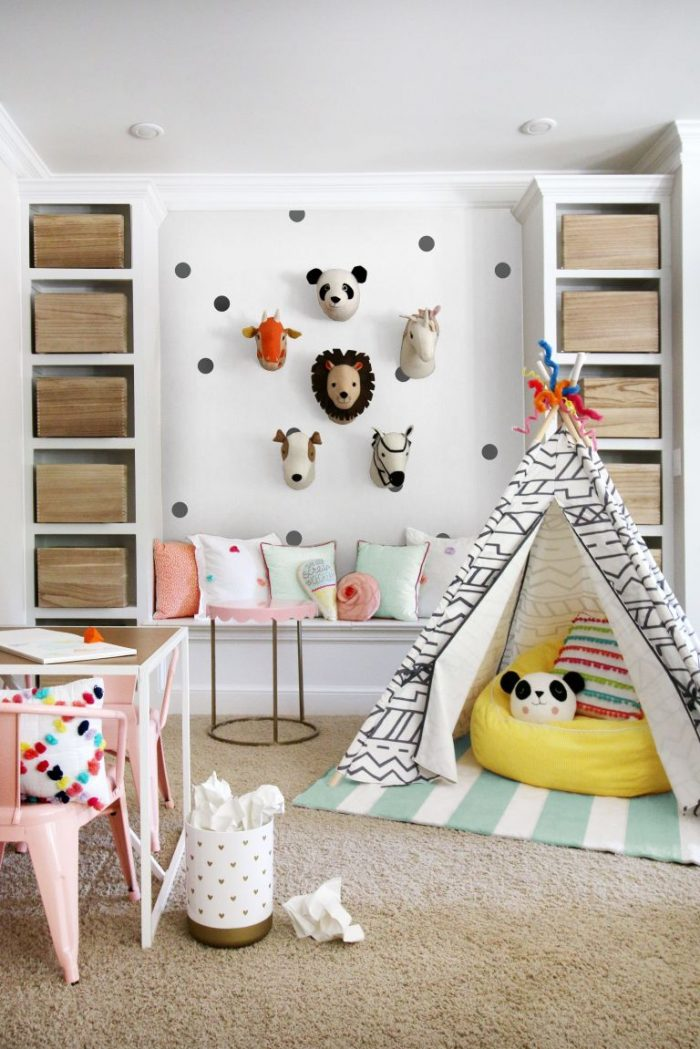 Cute and Organized Kids Playroom, love the wall of stuff heads!