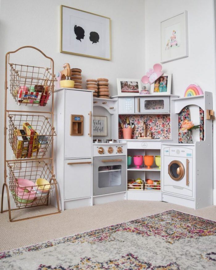 Cutest play kitchen! Love the floral wallpaper and gold accents!