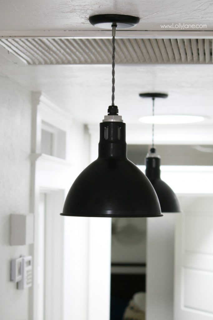 Love these black barn light pendants in this farmhouse makeover. Such a pretty farmhouse hallyway!