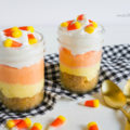 YUM! See how easy it is to make this yummy candy corn cheesecake! Such an easy fall dessert idea! Love these mason jar fall cheesecakes! Yummy fall cheesecake in a jar idea!