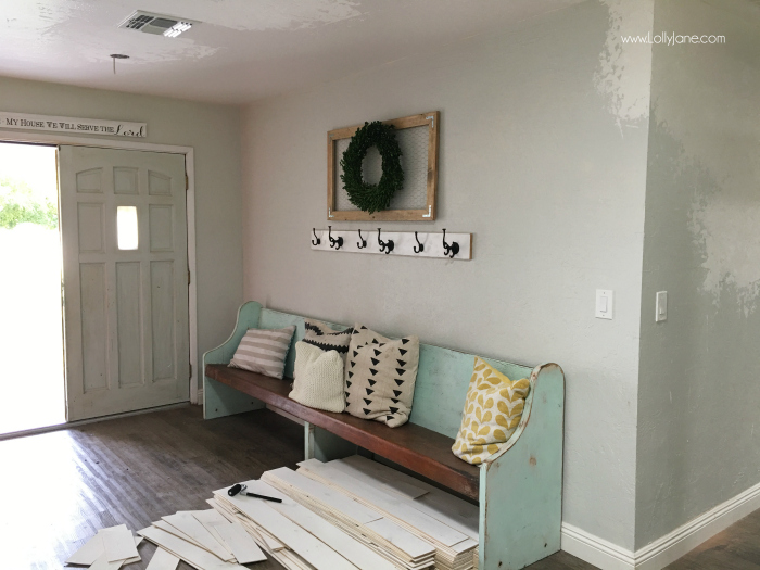Stikwood shiplap before and after pictures. You won't believe the difference this barnwood wall treatment makes on this farmhouse entrway!