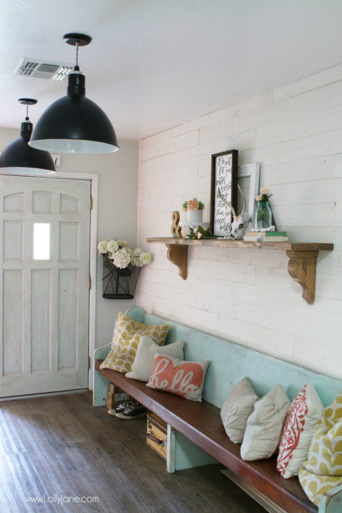 Such a fun farmhouse makeover: the shiplap entrway, black barn light pendants and farmhouse accessories really makeover this space.