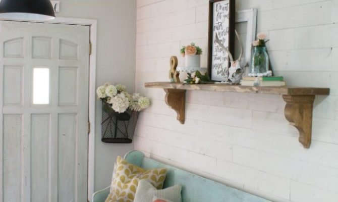 Loving this peel and stick reclaimed wood wall! Such an easy to apply shiplap wall treatment. Easy farmhouse wall decor idea!