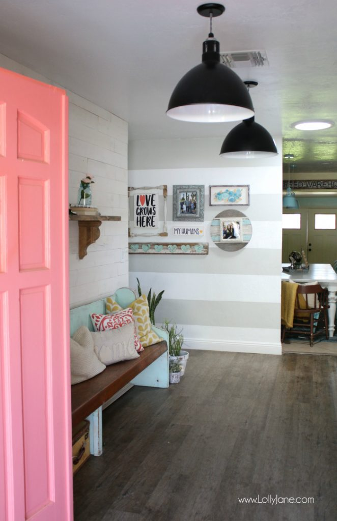 Loving this reclaimed wood wall against the striped accent hallway. Check out this easy way to shiplap your wall, brilliant peel and stick wood pieces!