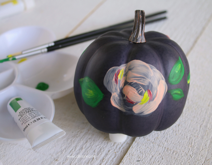 Spruce up boring pumpkins with Reeves acrylic paint and turn it into these cute plaid + floral pumpkins!