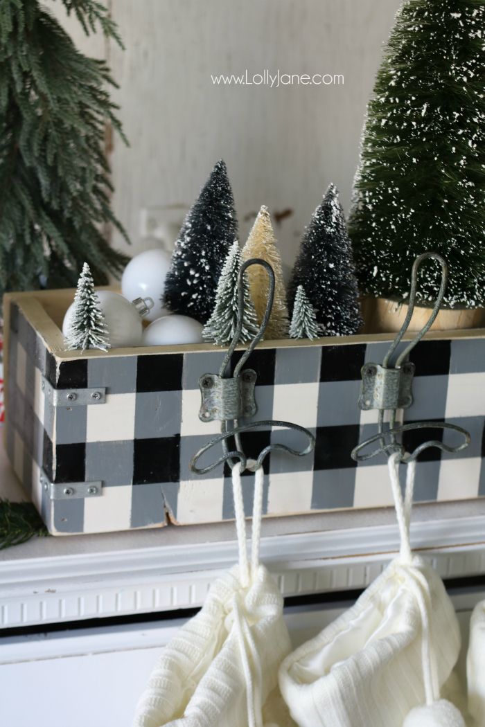 Love this farmhouse Christmas decor using bottle brush trees and buffalo check, love this easy wood stocking hanger too!