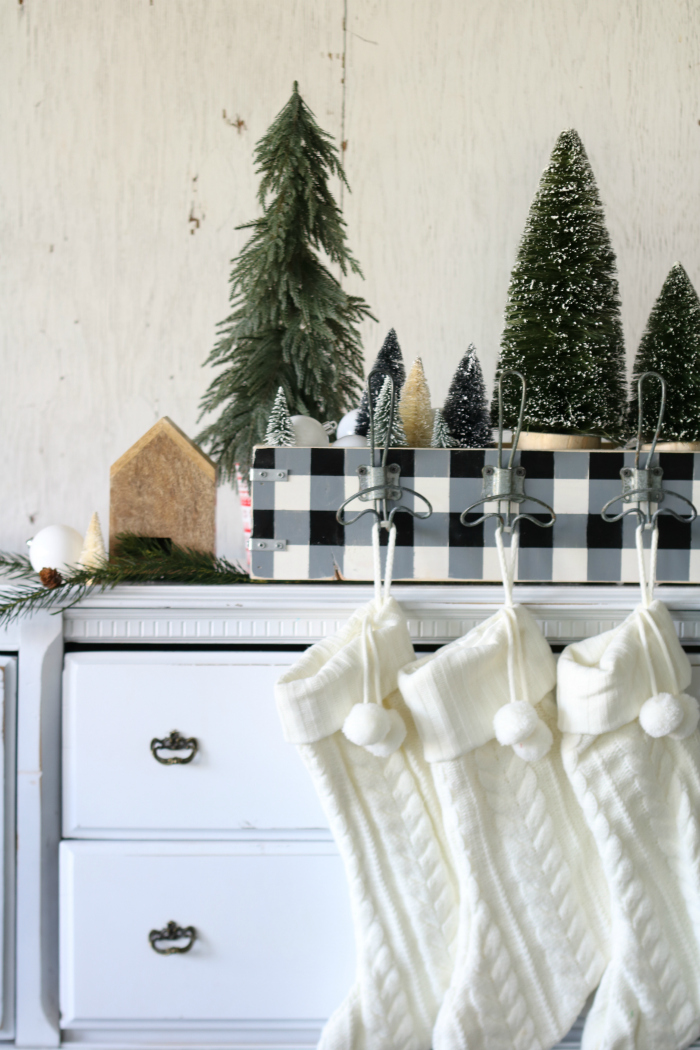 Love this easy buffalo check Christmas stocking hanger! Make this easy wood box, paint, add hooks to display stockings PLUS Christmas decor!