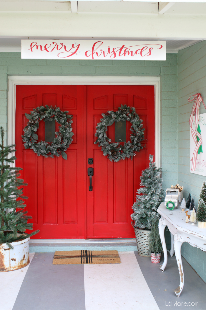 Red and white Christmas porch decorations. Lots of easy ways to make your outdoor Christmas porch cheery for the holidays!