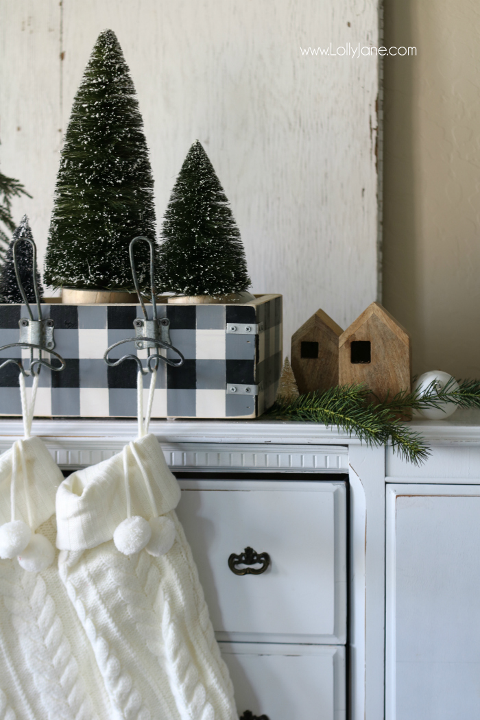 Get creative when hanging your stockings! This easy DIY wood stocking hanger is easy to build and houses cute farmhouse Christmas decor!