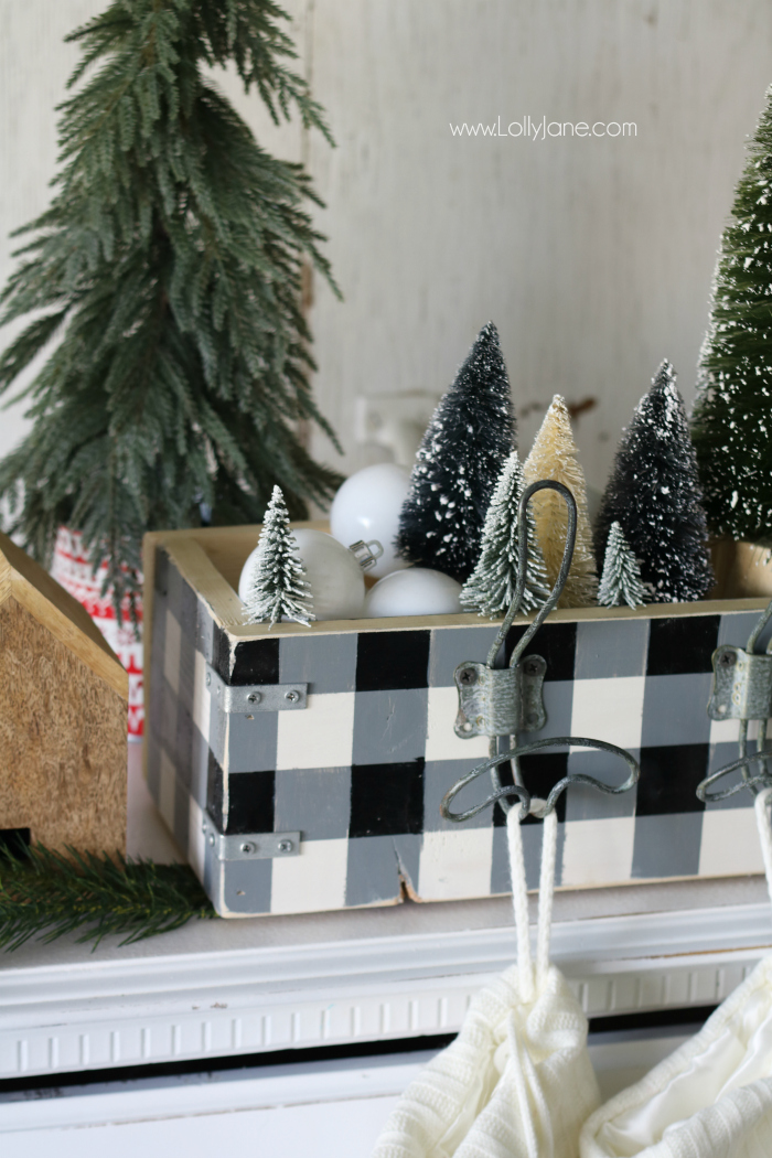 Spruce up your Christmas decor by making a stocking hanger! It displays your stockings and houses cute Christmas decor too like bottle brush trees and white ornaments!