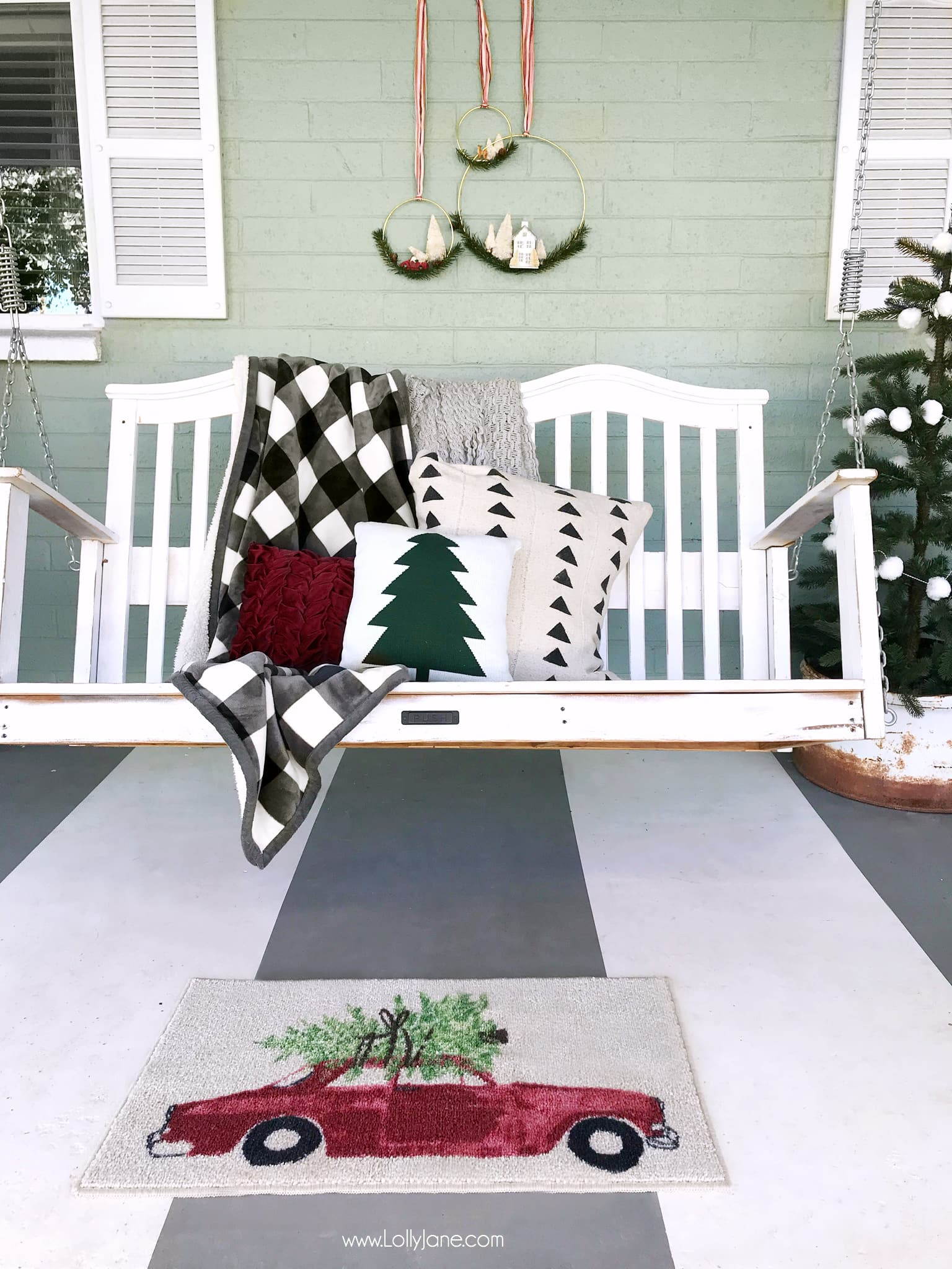 This Christmas porch is just simple and pretty! Mix handmade decor with store bought to make it pop! Love those bottle brush tree wreaths!