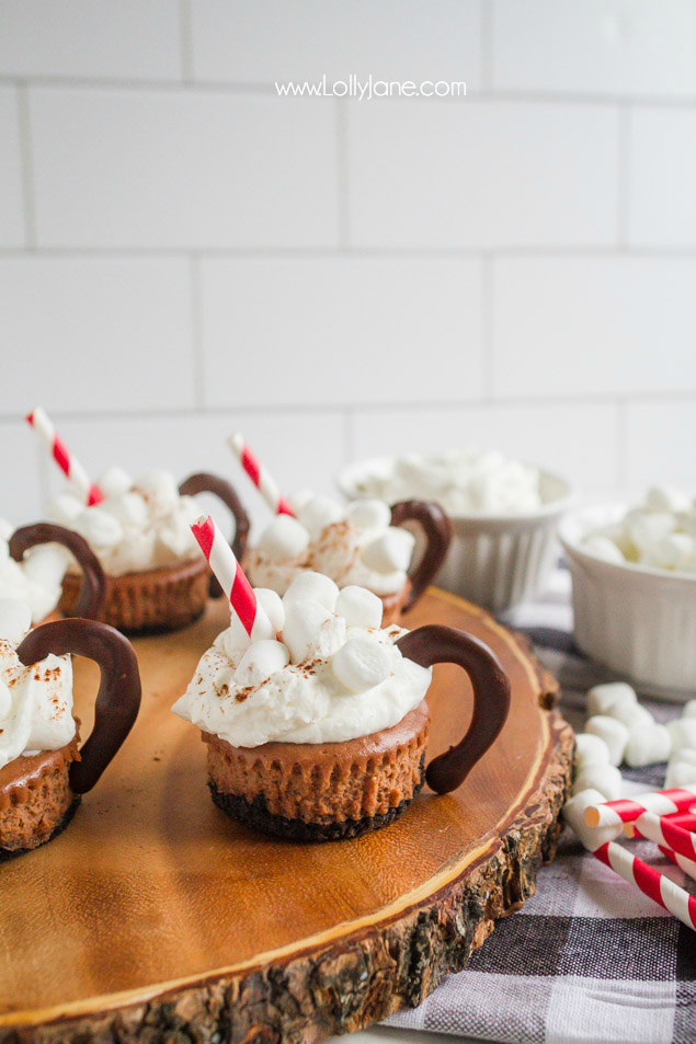 These mini hot cocoa cheesecake desserts are so cute and super tasty! These easy holiday treats are so yummy! Great holiday party dessert idea!