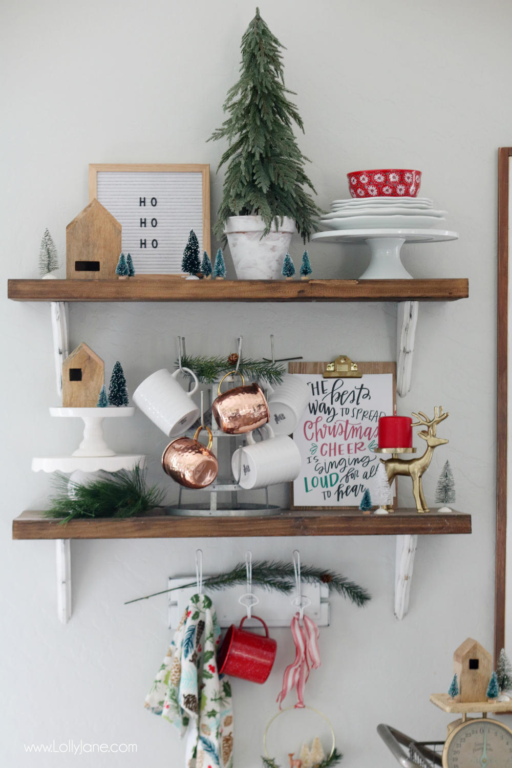 These modern farmhouse shelves all decked out for Christmas are too cute! Love the mug rack and cute cake stands! Love!