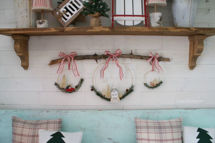 Love this trendy Christmas decor, such fun natural Christmas decor with a branch and hanging wreaths, love it.