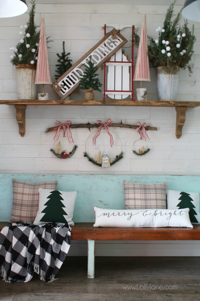 loving all these christmas mantel decor ideas like the wreaths hanging from a branch so - Christmas Mantel Decor