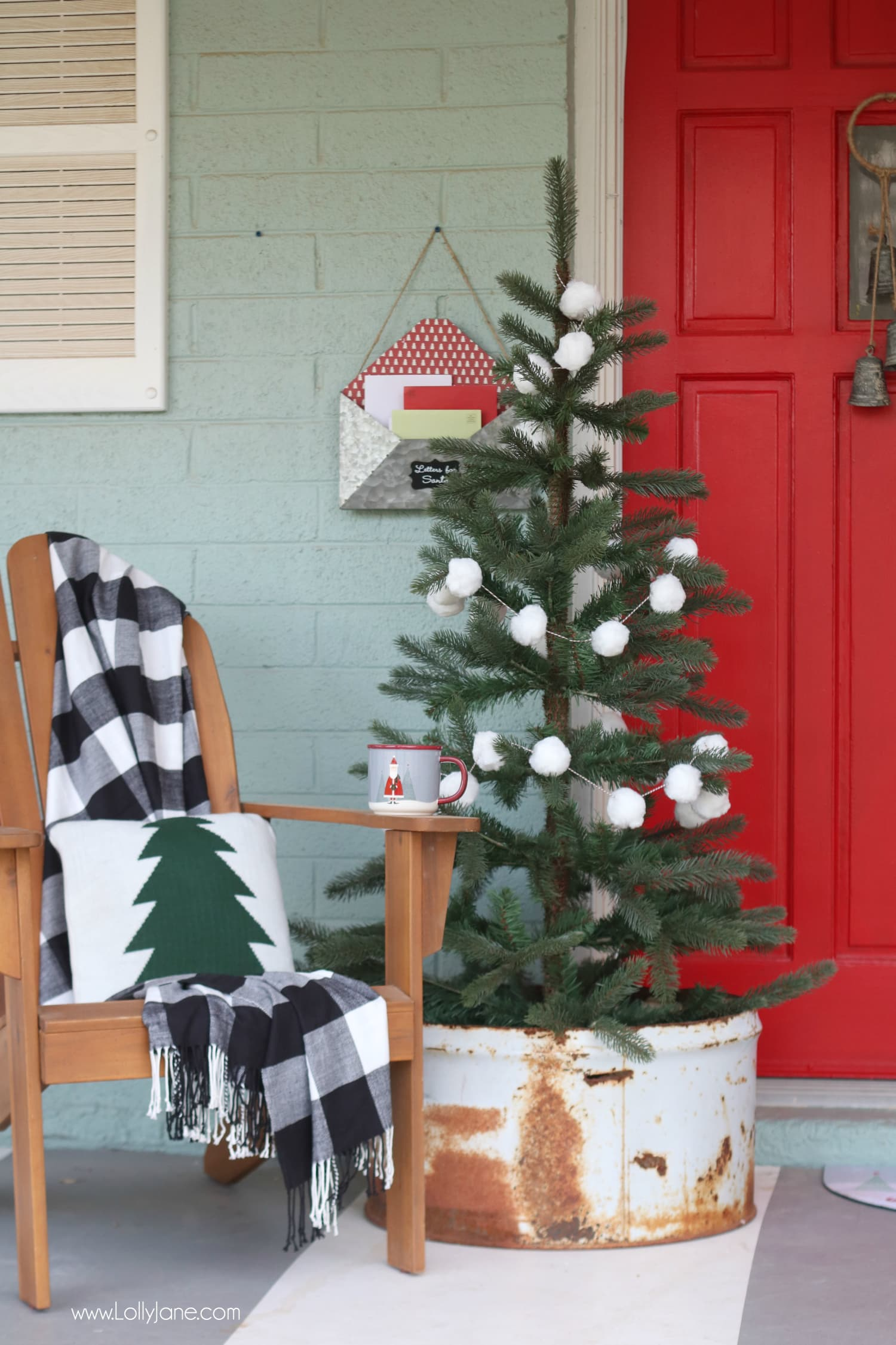 Cutest porch ever! The buffalo check throw with the EASY diy pom pom garland is such a cute combo, make your porch pop in less than 20 minutes and for less than $10! SO cute!