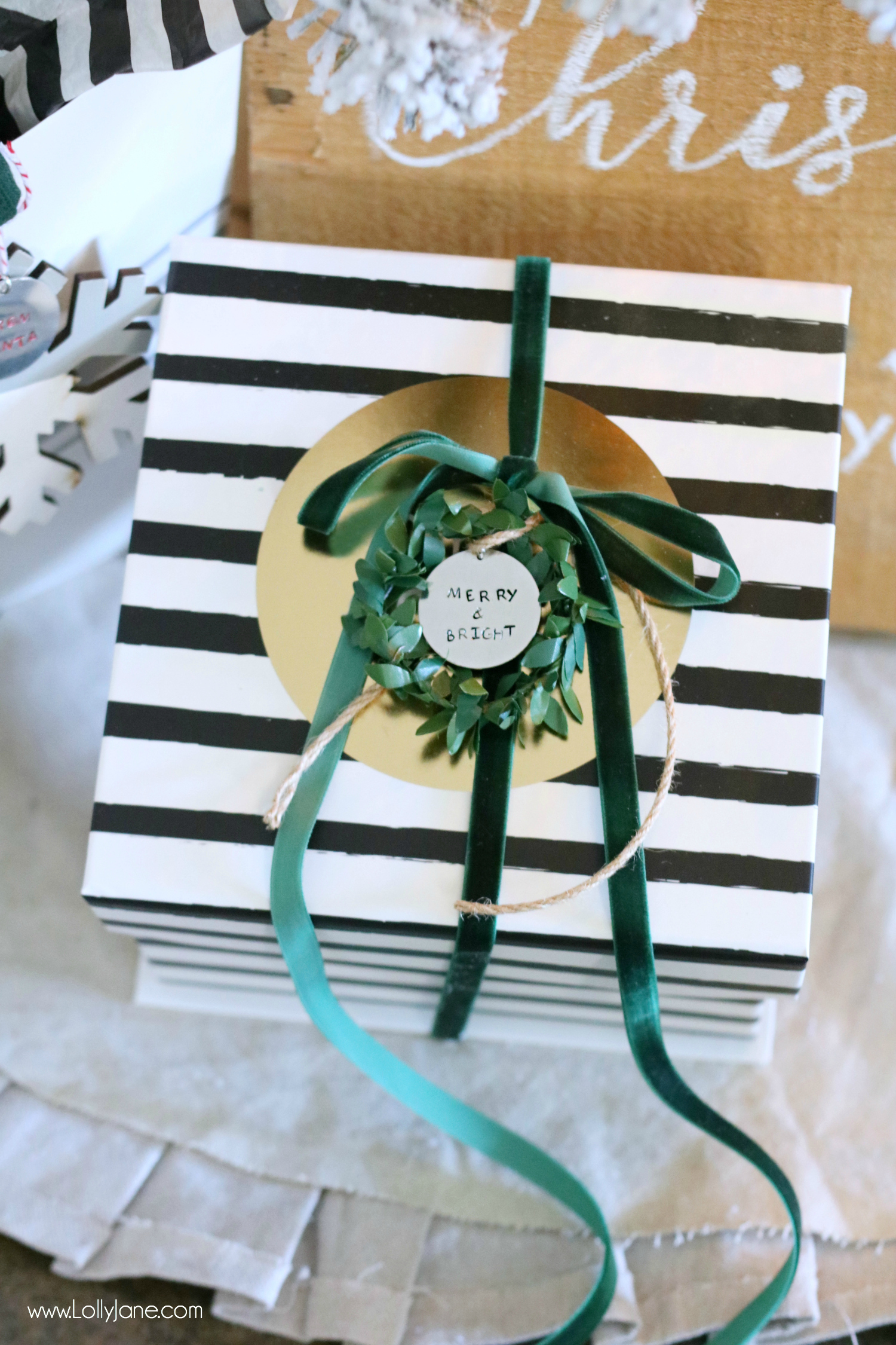 Love this DIY Stamped Metal Tag, perfect to tie onto Christmas or holiday gifts to personalize it. So pretty and EASY to make!