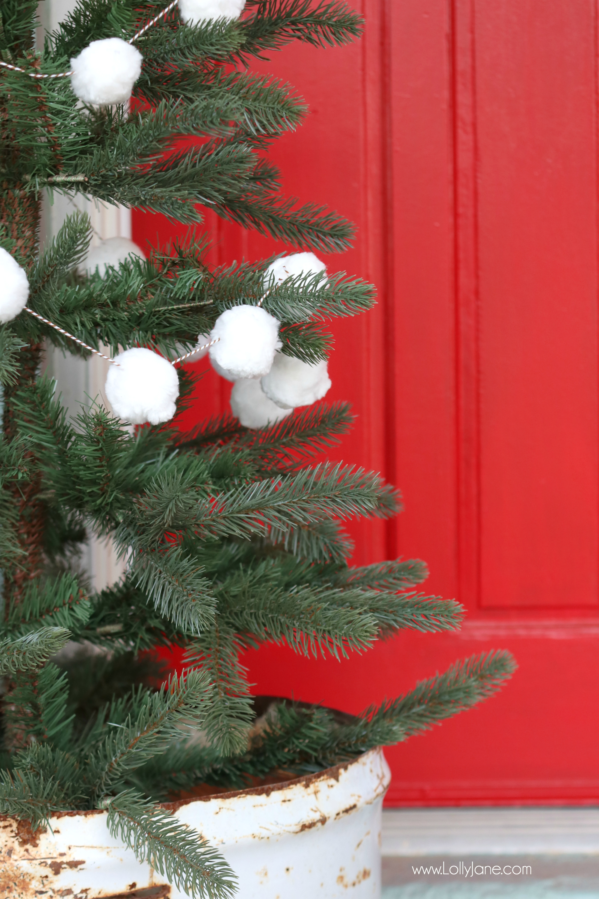 White pom pom christmas tree garland tutorial look at those cute puffy balls up close so festive and makes the green branches really pop solutioingenieria Image collections