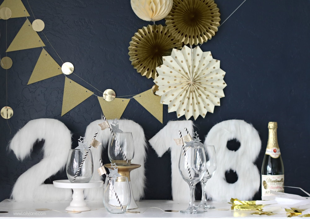 Cutest NYE display, love the simple decor like these DIY Fur Numbers. Spruce your NYE table in no time at all!