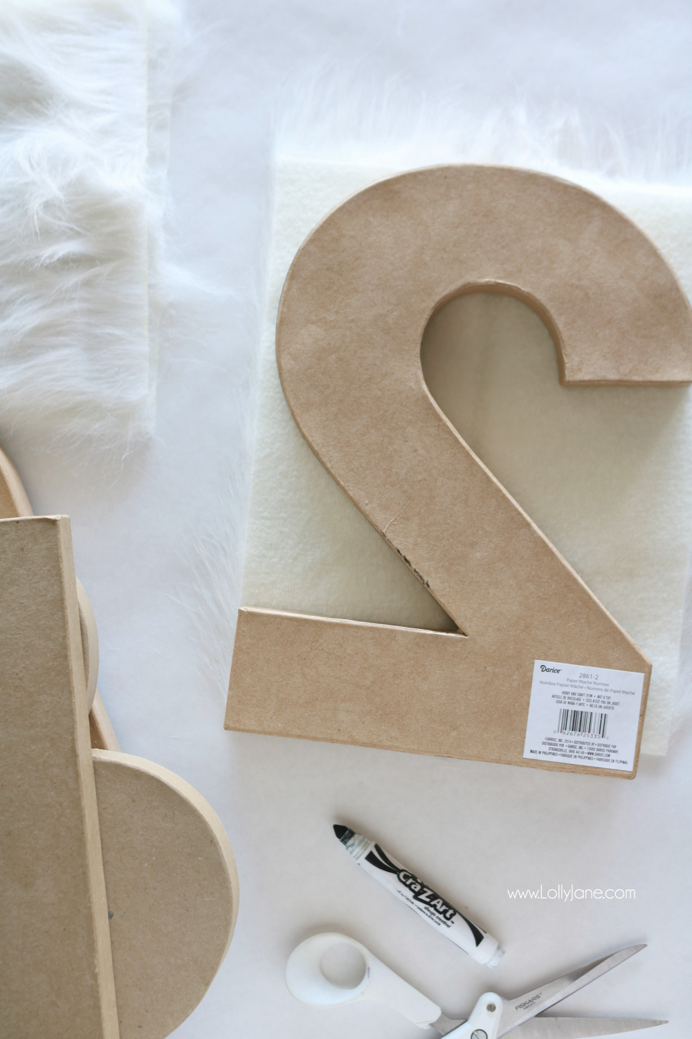 Give your paper numbers a little makeover with these easy DIY Fur Numbers tutorial!