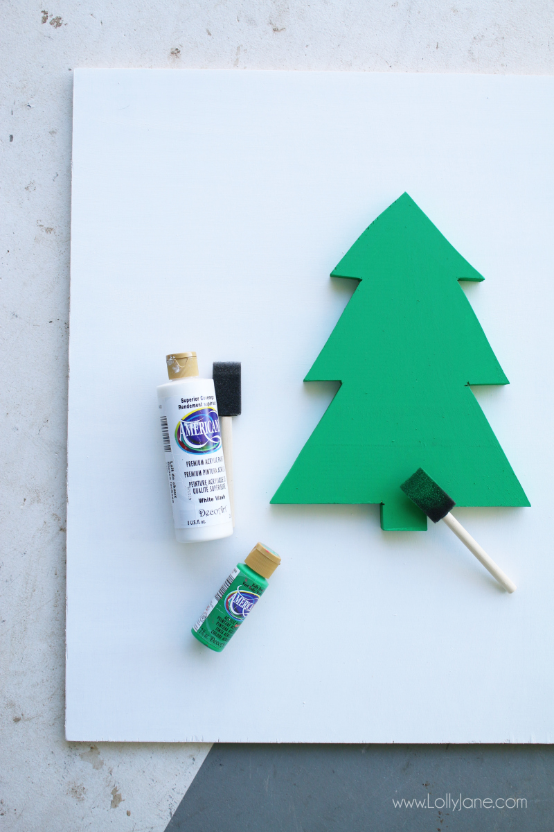 Such a cute red white and green painted farm fresh Christmas tree sign! Love this easy tutorial on how to make a farm fresh Christmas tree sign!