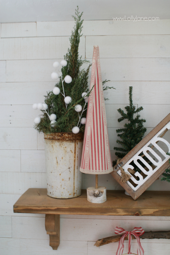 Use vintage white buckets filled with greenery for easy Christmas decor! Love the added white pom poms for a farmhouse Christmas mantel!