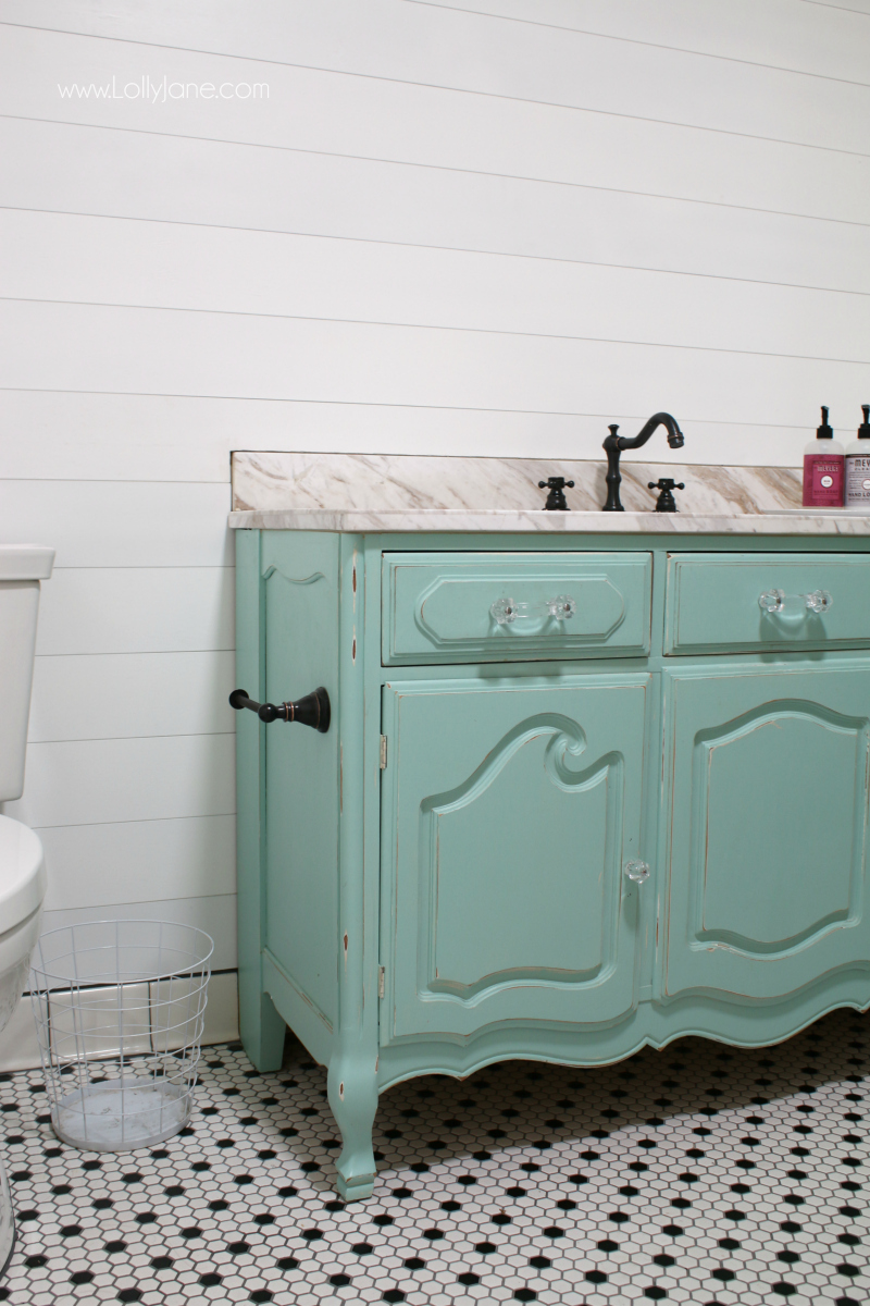 Loving this fun colored aqua vanity from a dresser! Classic shilap that's easy to apply makes this bathroom remodel a breeze!