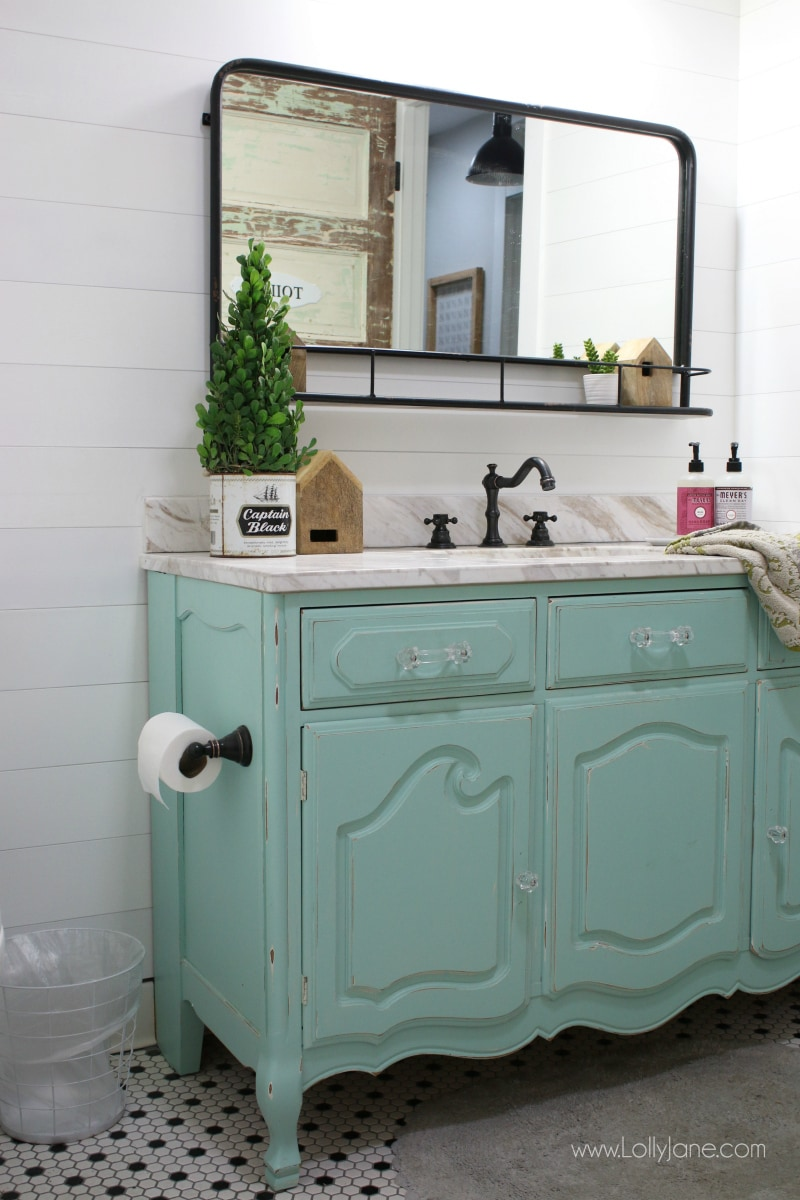 Love this aqua dresser to vanity makeover. Such an easy way to turn an old dresser into a bathroom vanity to give it new life. Love this colorful farmhouse bathroom decor!