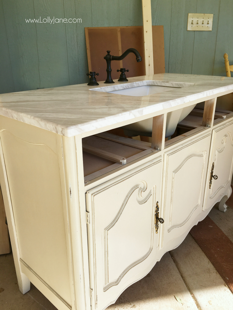 How to turn a dresser into a bathroom vanity! Love this farmhouse bathroom remodel and the classic decor!