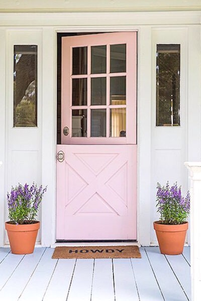 Gah! Dying over this light pink front door! It's called Peppermint Pink from Benjamin Moore and is such a pretty pink exterior door color! Stunning front door!