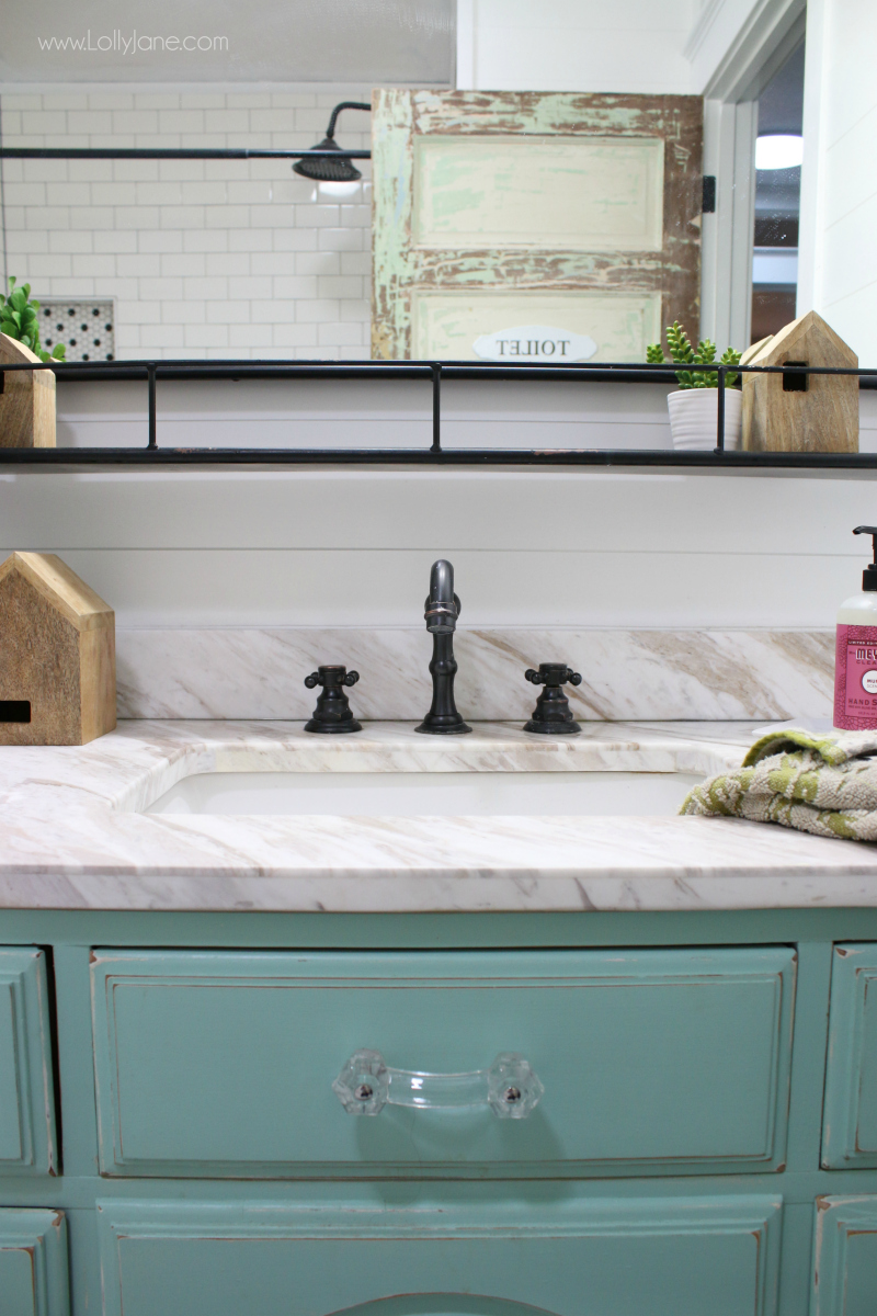 Modern farmhouse bathroom decor. Love this oil rubbed bronze sink with a marble vanity top and aqua dresser turned vanity. Love this farmhouse bathroom remodel!