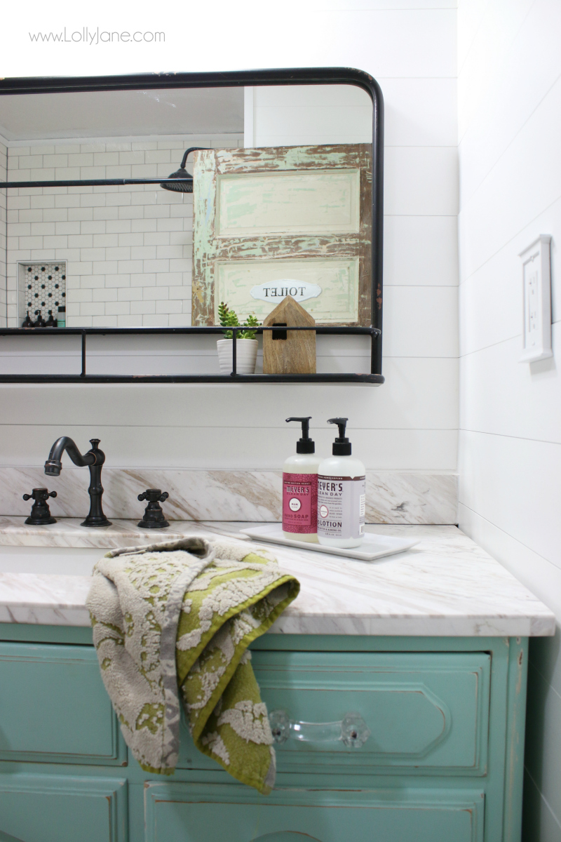 Adore this pharmacy mirror bathroom decor! This faux vintage mirror is so fun!-mimics the old vintage mirrors without the hard work of restoring it. Such a cute bathroom remodel!